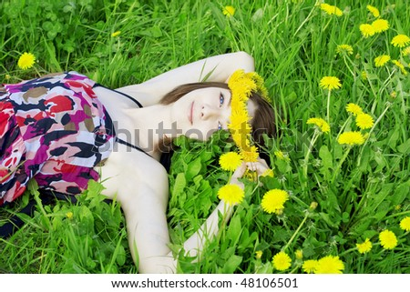 The image of a beautiful girl on a background of flowering flowers - stock photo