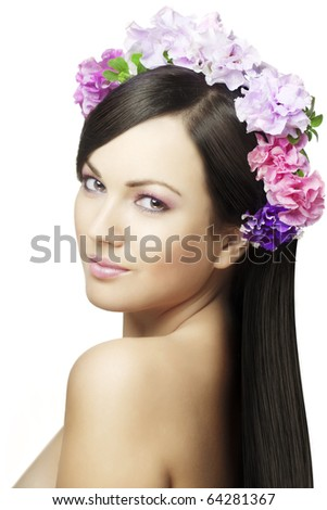 The image of a beautiful girl with a wreath of flowers on her head