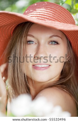 The image of a beautiful woman among flowering gardens
