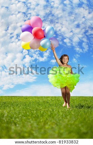 The image of a child with a bunch of balloons in their hands - stock photo