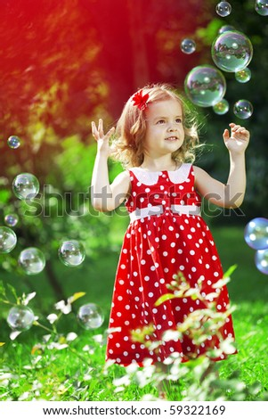 The image of a cute little girl with bubbles - stock photo