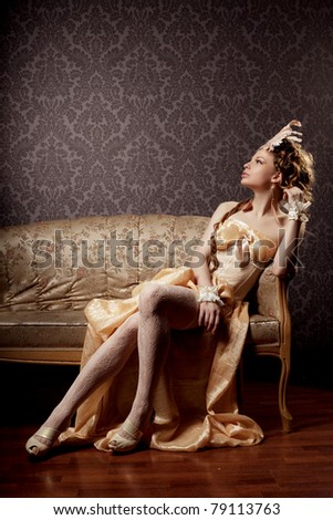 The image of a girl in a luxurious vintage-style - stock photo