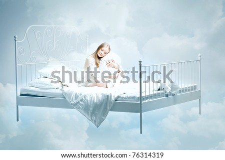 The image of a girl lying on the bed - stock photo