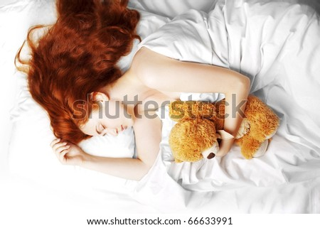 The image of a girl sleeping in bed in his room - stock photo