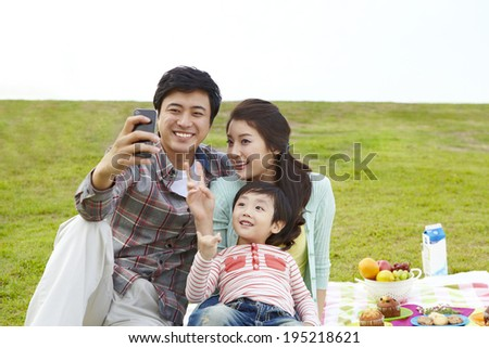 the image of a happy Asian family having a picnic