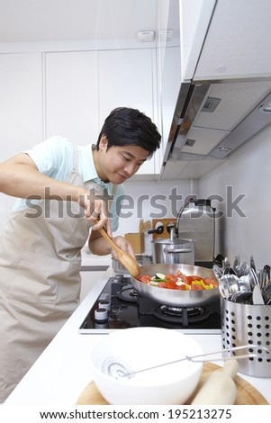 the image of a happy Asian father preparing food