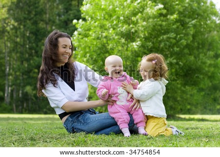 The image of a happy family in the park.
