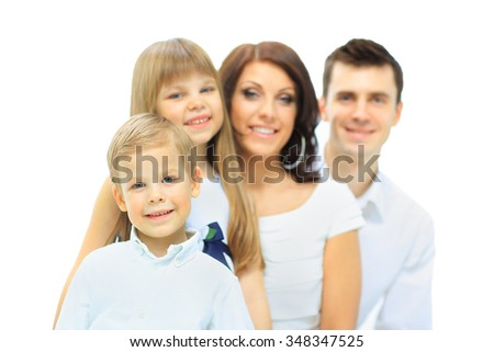 the image of a happy family with smiling son in the foreground - stock photo