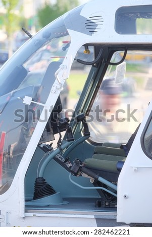 The image of a helicopter cockpit - stock photo