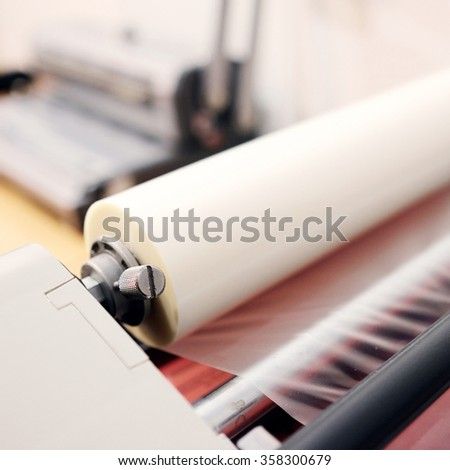 The image of a laminating machine - stock photo