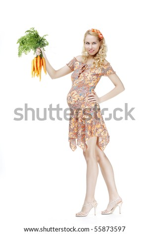 The image of a pregnant girl with a bunch of carrots