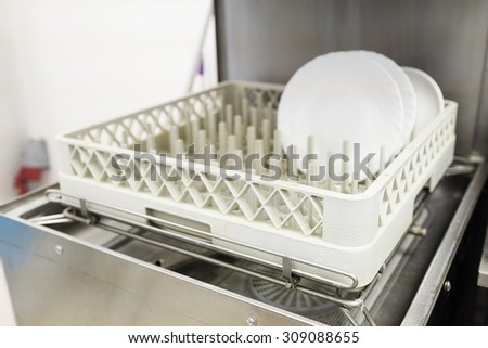 The image of a professional dishwasher - stock photo