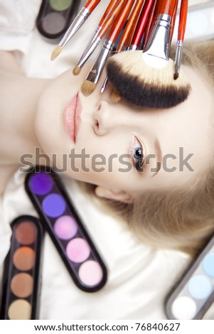The image of a professional stylist make-up brushes in their hands - stock photo