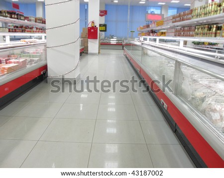 the image of a rows in a supermarket - stock photo