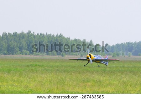 The image of a sport propeller airplane - stock photo