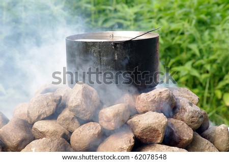 The image of a stones on which is brewed pot - stock photo