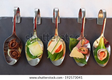 the image of an appetizers  on party spoons - stock photo