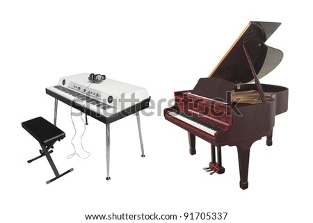 The image of an electronic synthesizer and piano under the white background - stock photo