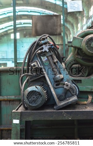 The image of an used engine in empty factory
