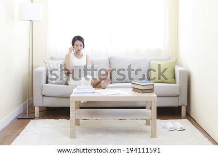 the image of Asian businesswoman and working at home
