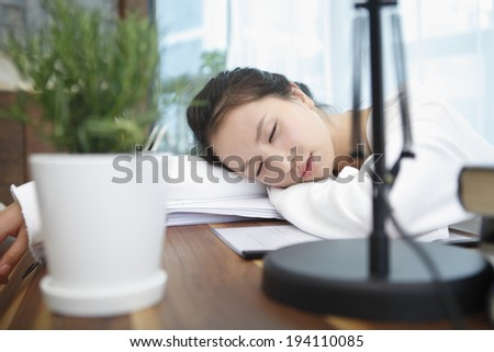 the image of Asian businesswoman and working at home and taking a nap - stock photo