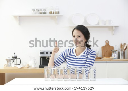 the image of Asian woman in kitchen