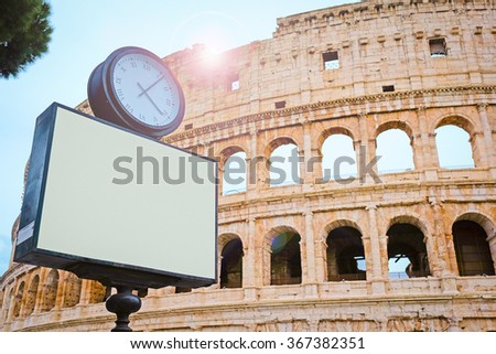 The image of clock against the Colosseum in Roma, Italy - stock photo