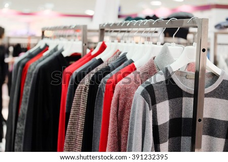 The image of clothes on a hanger in clothes shop - stock photo