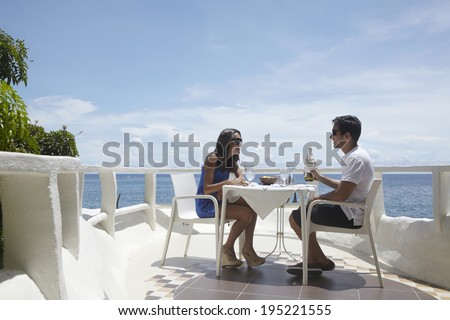 the image of couple having breakfast by the sea in Boracay in the Philippines