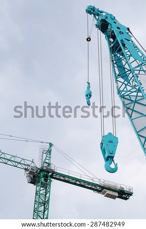 The image of crane under the sky - stock photo