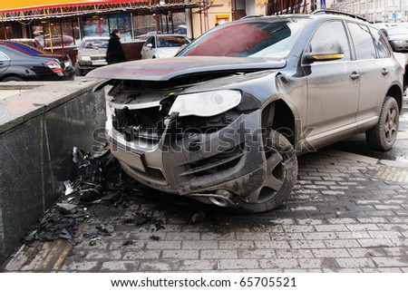 The image of crashed car stands on a sidewalk - stock photo