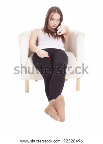The image of girl with a remote control