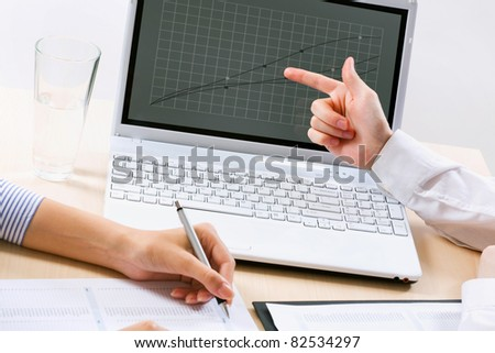 The image of hands for business partners in the discussion document - stock photo
