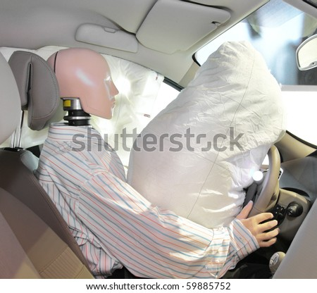 The image of mannequin in a car after crash-test - stock photo