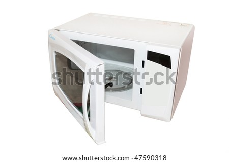The image of open microwave under the white background.  - stock photo