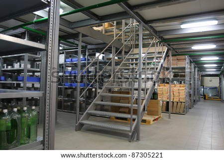 The image of shelves in the warehouse