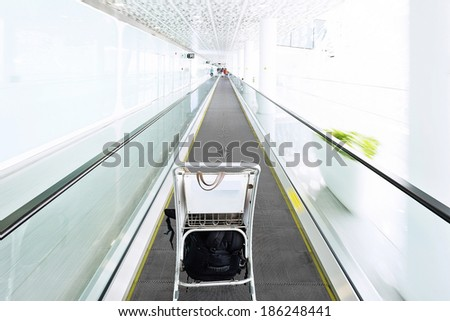 The image of shopping cart on the elevator. - stock photo