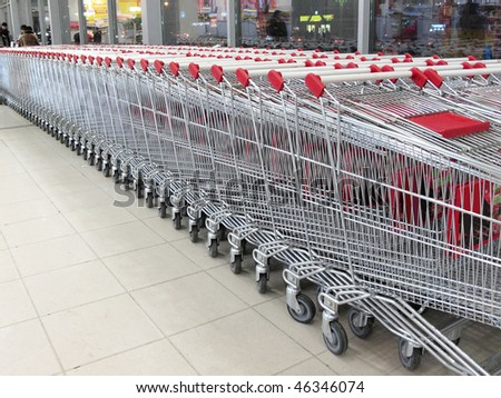 The image of shopping trolleys stands at the supermarket - stock photo