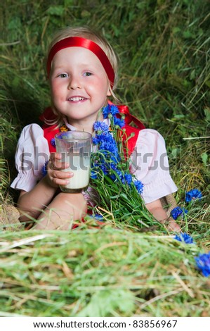 The image of the beautiful girl on a mow - stock photo
