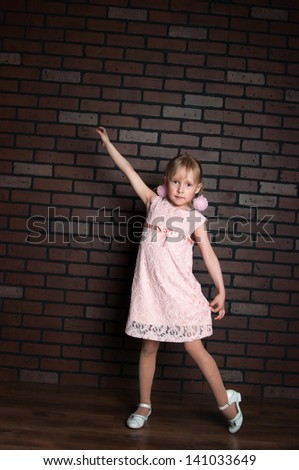 The image of the elegant girl in a pink dress - stock photo