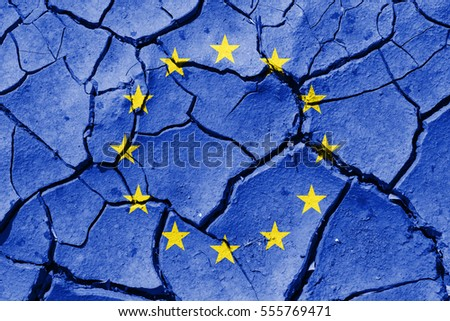 The image of the flag of European Union on the cracked dry ground