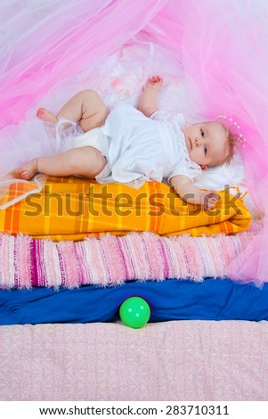 "the image of the girl in attributes of the fairy tale ""The Princess on a Pea"""