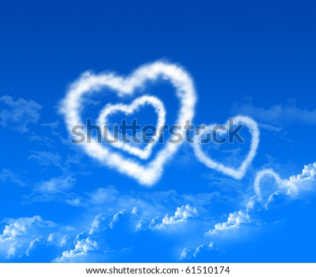 The image of the heart in the blue sky of clouds. - stock photo