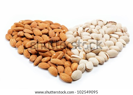 The image of the heart of the almond and pistachio nuts. - stock photo