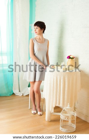 The image of the lovely girl about the served  table