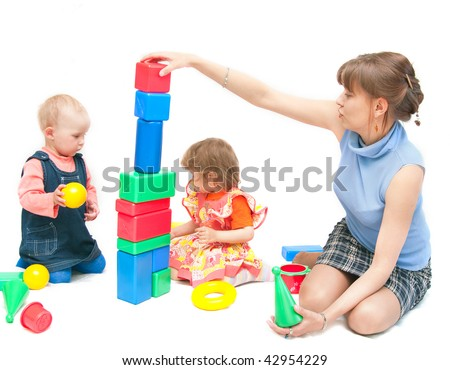 The image of the woman playing with girls - stock photo