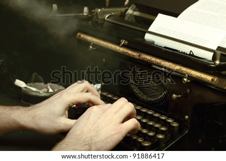 The image of the writer or the reporter behind the typewriter in retrostyle with a cigaret smoke - stock photo