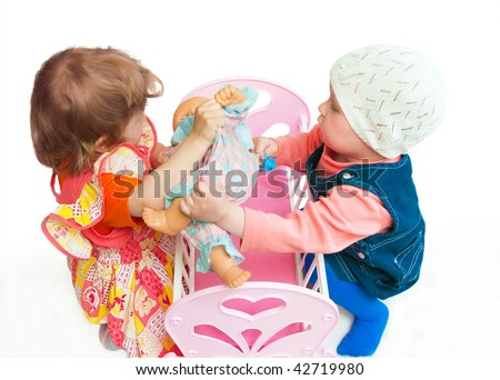 The image of two girls playing a white background - stock photo