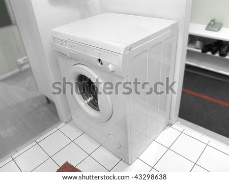 The image of washer stands at the bathroom - stock photo