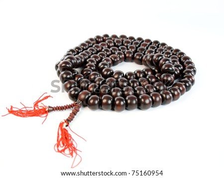 The image of wooden rosary isolated on white background - stock photo